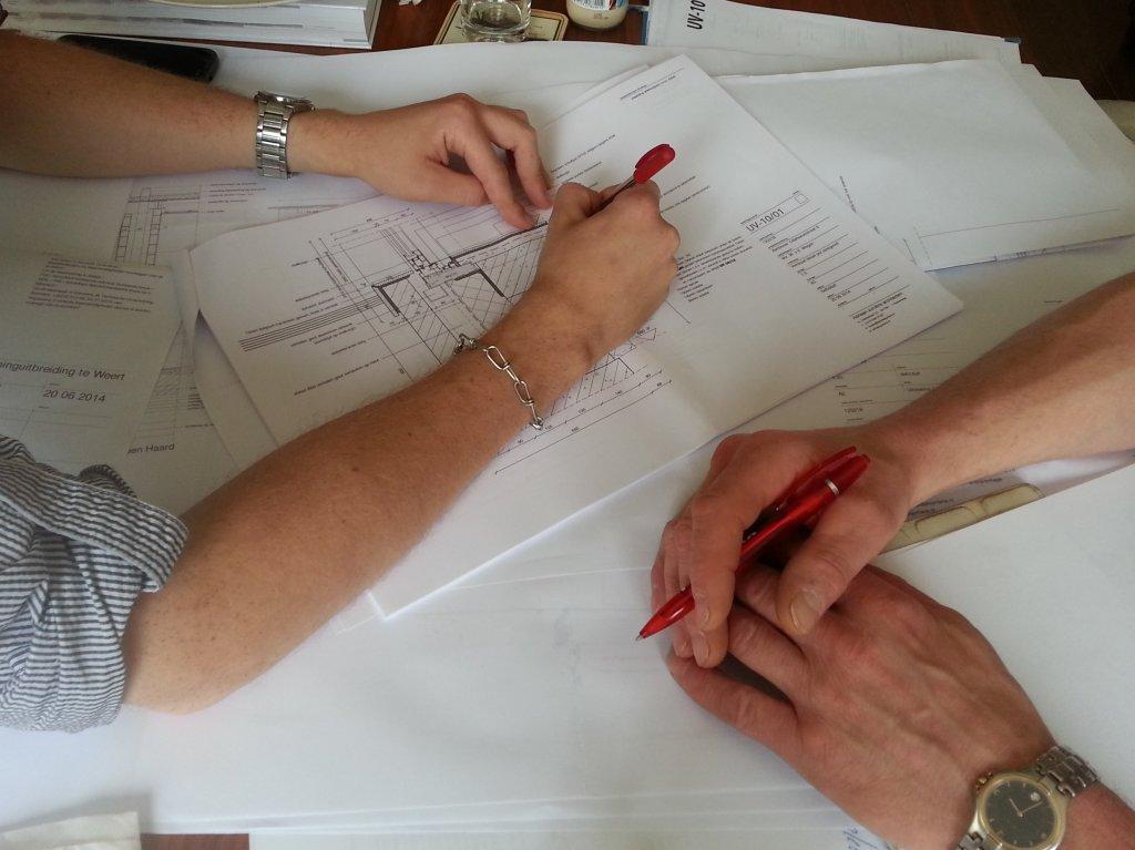 Bespreking bouwplannen
